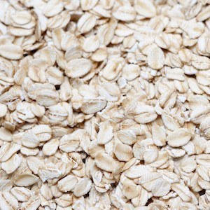 Background of rolled oats, a grain cereal in which the seeds have been milled and rolled for use as a cooking ingredient and breakfast cereal